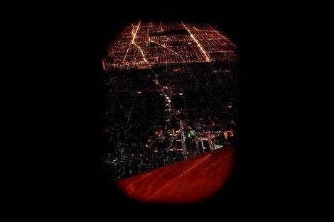 Airplane window city night