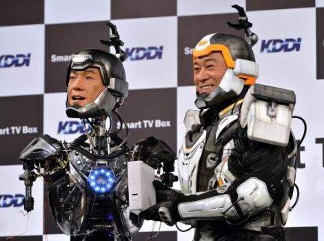 "Japanese actor Ken Matsudaira (R), clad in a robot suit, smiles with an android robot (L) in his likeness called ""Real Android Matsuken"" at a press presentation in Tokyo on November 19, 2013. The android robot was developed for an advertisement for Japanese telecom company KDDI.      AFP PHOTO / YOSHIKAZU TSUNO     '        (Photo credit should read YOSHIKAZU TSUNO/AFP/Getty Images)"